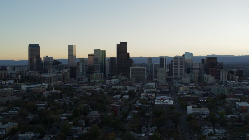 5.7K stock footage aerial video of the city skyline at sunset while approaching and ascending, Downtown Denver, Colorado Aerial Stock Footage | DX0001_001835