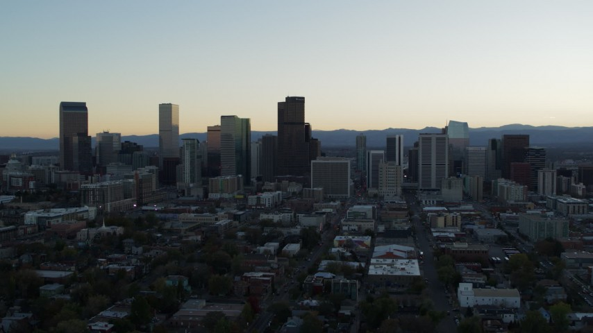 5.7K stock footage aerial video reverse view of the city skyline during descent at sunset, Downtown Denver, Colorado Aerial Stock Footage | DX0001_001836
