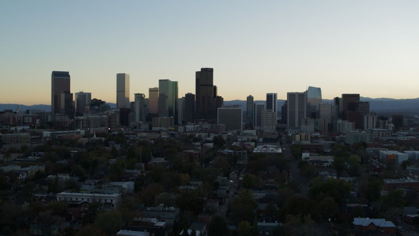 5.7K stock footage aerial video of the city skyline during descent at sunset, Downtown Denver, Colorado Aerial Stock Footage | DX0001_001837