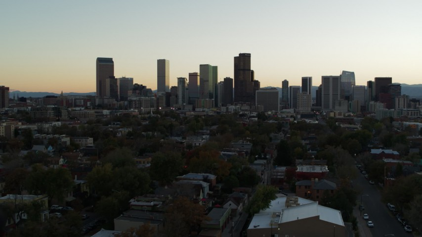 5.7K stock footage aerial video of a reverse view of the city skyline at sunset, Downtown Denver, Colorado Aerial Stock Footage | DX0001_001838