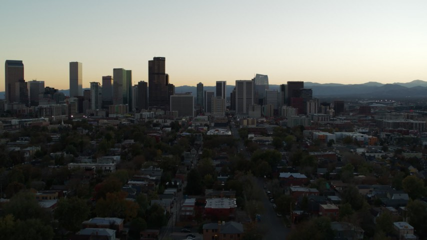 5.7K stock footage aerial video approach of the city skyline at sunset during ascent, Downtown Denver, Colorado Aerial Stock Footage | DX0001_001839