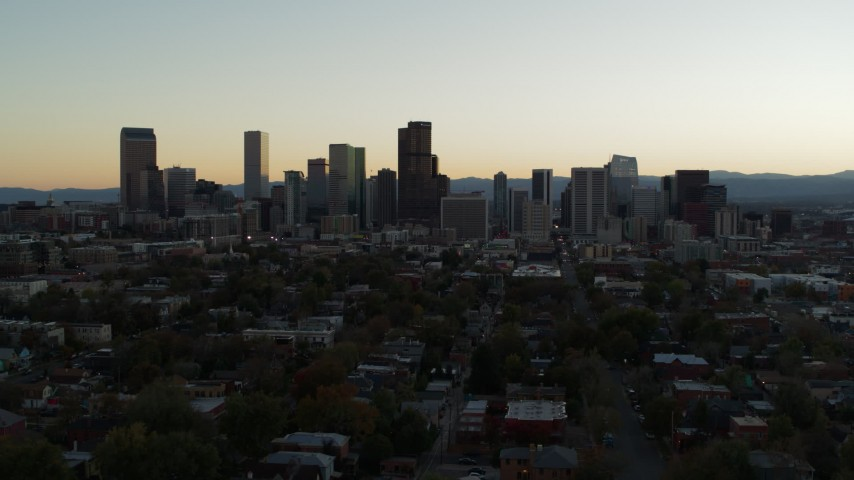 5.7K stock footage aerial video fly away from the city skyline at sunset during descent, Downtown Denver, Colorado Aerial Stock Footage | DX0001_001840