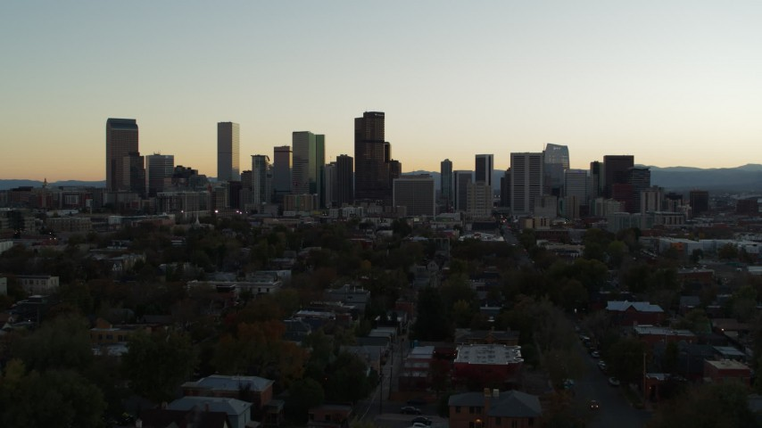 5.7K stock footage aerial video fly toward the city skyline at sunset during ascent, Downtown Denver, Colorado Aerial Stock Footage | DX0001_001841