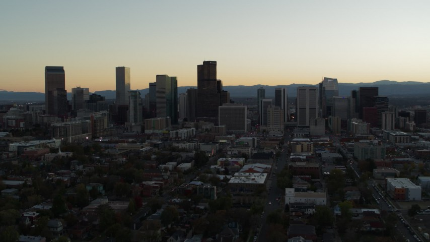 5.7K stock footage aerial video flyby the city skyline at sunset during descent, Downtown Denver, Colorado Aerial Stock Footage | DX0001_001842
