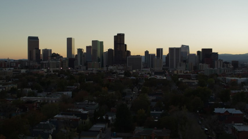 5.7K stock footage aerial video of flying by the city's skyline at sunset in Downtown Denver, Colorado Aerial Stock Footage | DX0001_001845