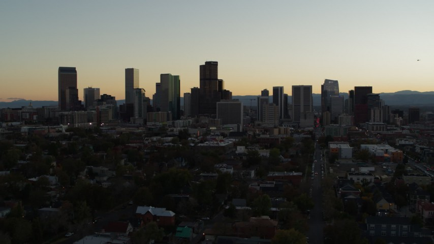 5.7K stock footage aerial video of flying by the city's skyline at sunset and ascending in Downtown Denver, Colorado Aerial Stock Footage | DX0001_001846