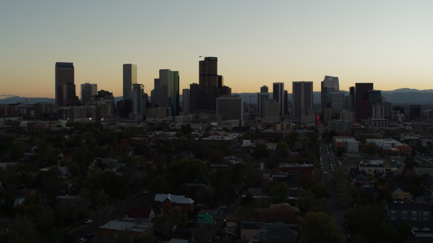 5.7K stock footage aerial video of flying by the city's skyline at sunset and descending in Downtown Denver, Colorado Aerial Stock Footage | DX0001_001847
