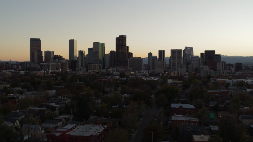 5.7K stock footage aerial video ascend while flying by the city's skyline at sunset, Downtown Denver, Colorado Aerial Stock Footage | DX0001_001849