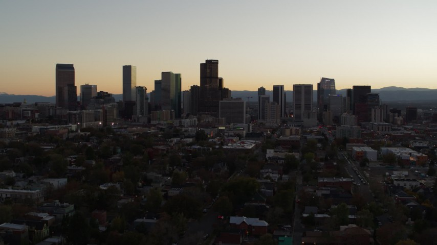 5.7K stock footage aerial video slow descent while flying by the city's skyline at sunset, Downtown Denver, Colorado Aerial Stock Footage | DX0001_001850
