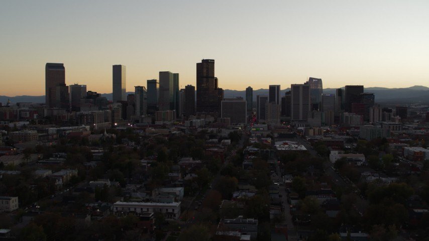 5.7K stock footage aerial video slow ascent while flying by the city's skyline at sunset, Downtown Denver, Colorado Aerial Stock Footage | DX0001_001851