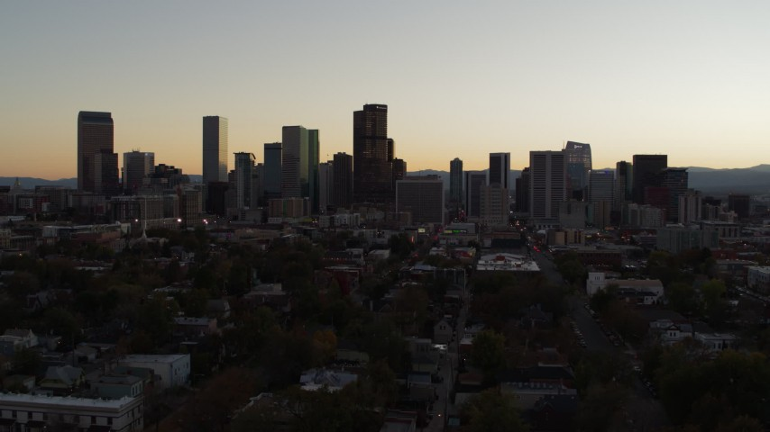 5.7K stock footage aerial video slow descent while flying away from the city's skyline at sunset, Downtown Denver, Colorado Aerial Stock Footage | DX0001_001852