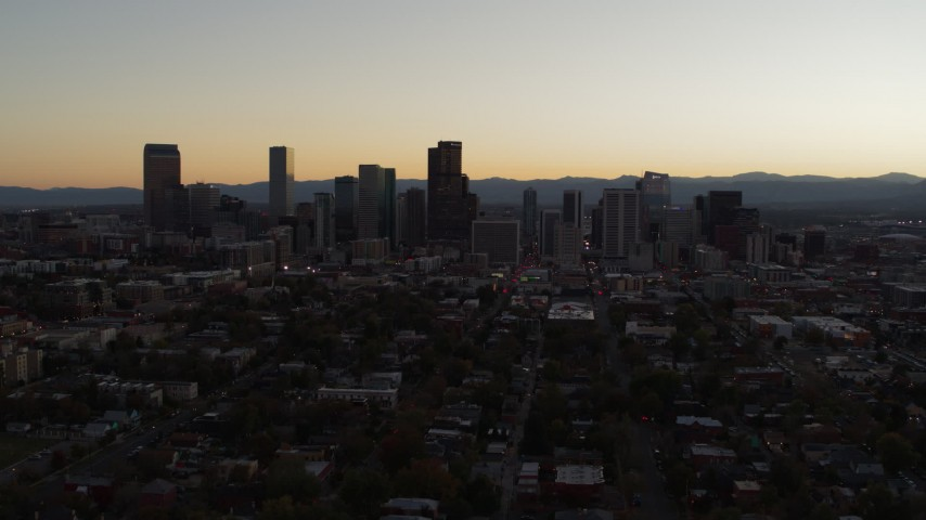5.7K stock footage aerial video slowly flying away from the city's skyline at sunset, Downtown Denver, Colorado Aerial Stock Footage | DX0001_001853