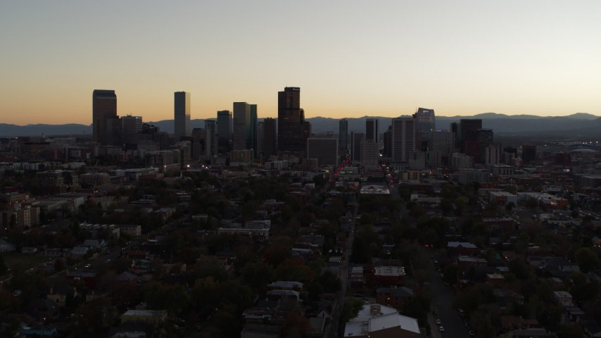 5.7K stock footage aerial video slow descent with view of the city's skyline at sunset, Downtown Denver, Colorado Aerial Stock Footage | DX0001_001854
