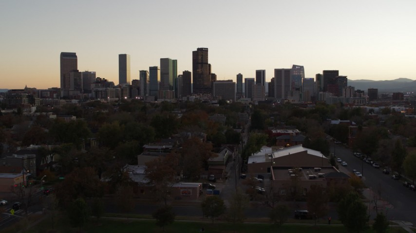 5.7K stock footage aerial video of approaching the city's skyline at sunset, Downtown Denver, Colorado Aerial Stock Footage | DX0001_001855