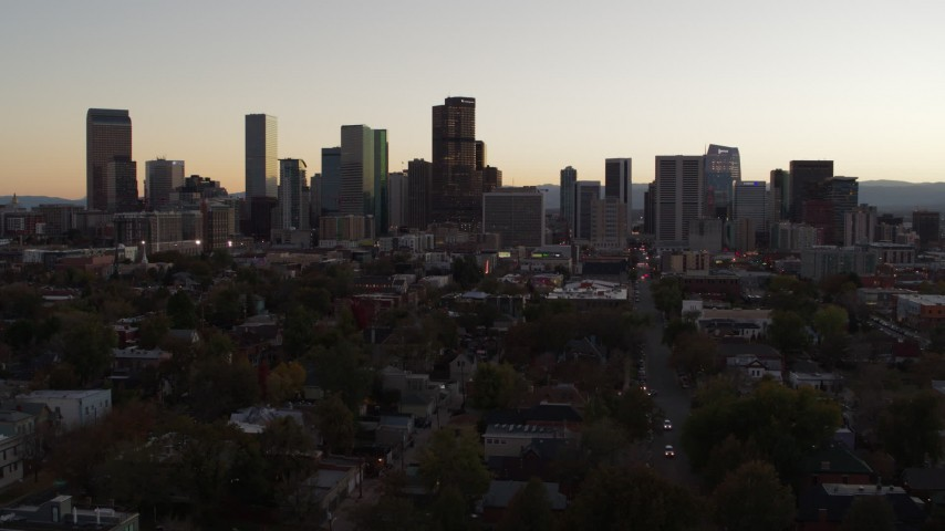 5.7K stock footage aerial video of flying by and away from the city's skyline at sunset, Downtown Denver, Colorado Aerial Stock Footage | DX0001_001856