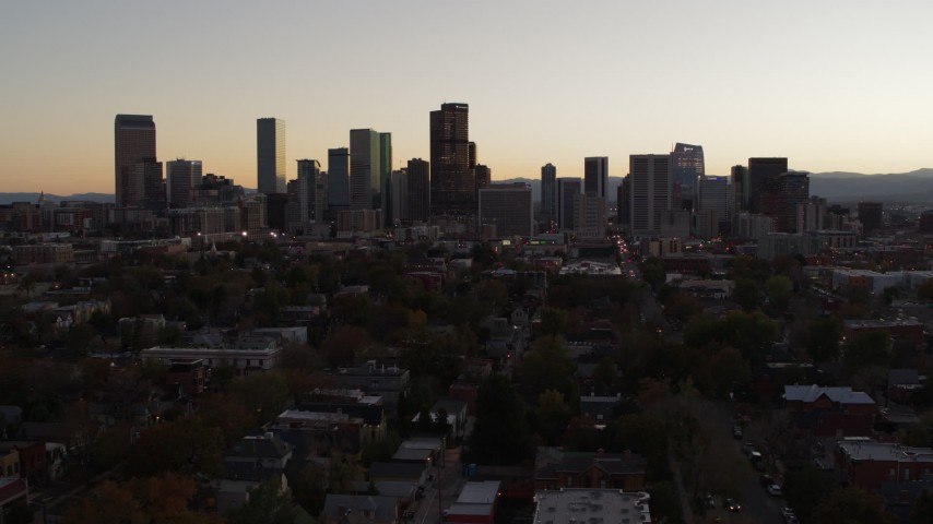 5.7K stock footage aerial video of a reverse view of the city's skyline at sunset, Downtown Denver, Colorado Aerial Stock Footage | DX0001_001859
