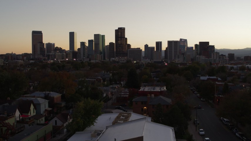 5.7K stock footage aerial video of the city's skyline at sunset during descent, Downtown Denver, Colorado Aerial Stock Footage | DX0001_001860