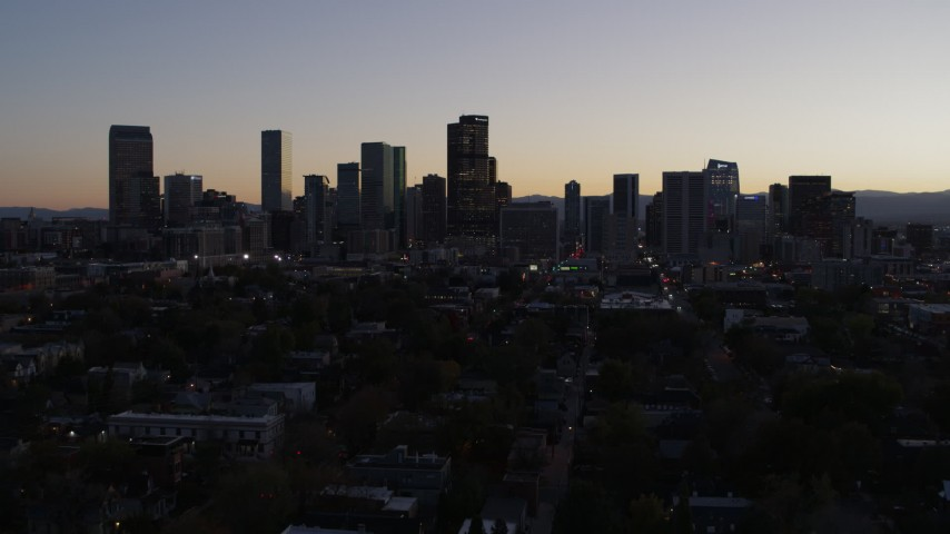 5.7K stock footage aerial video ascend and approach the city's skyline at twilight, Downtown Denver, Colorado Aerial Stock Footage | DX0001_001861