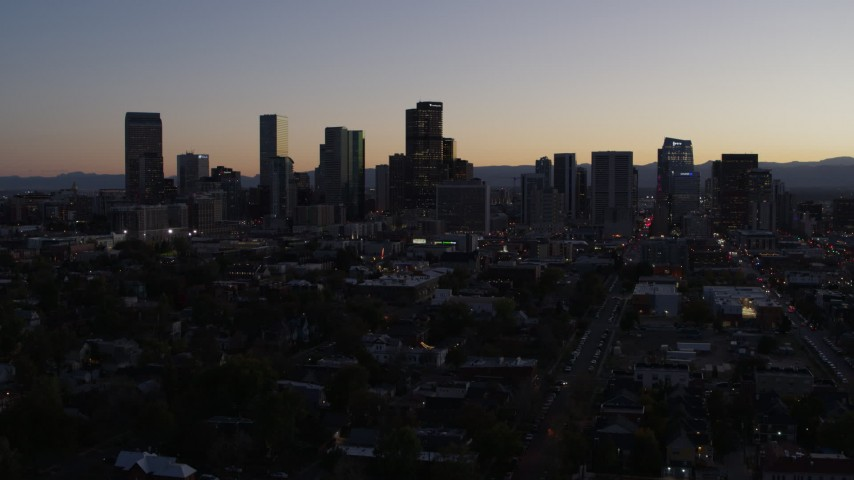 5.7K stock footage aerial video of the city's skyline at twilight while flying away, Downtown Denver, Colorado Aerial Stock Footage | DX0001_001862