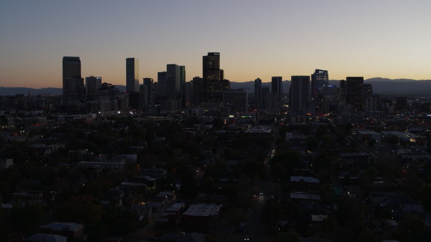 5.7K stock footage aerial video of flying by the city's skyline at twilight, Downtown Denver, Colorado Aerial Stock Footage | DX0001_001863