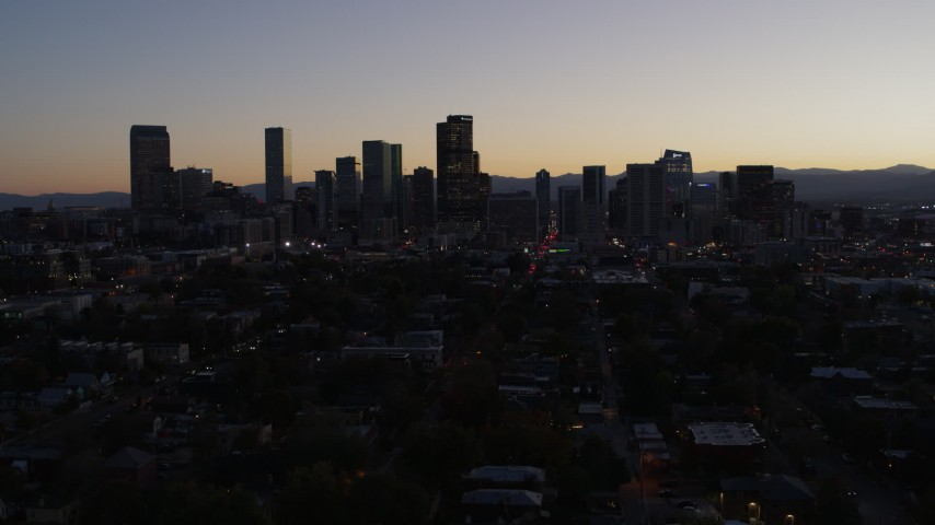 5.7K stock footage aerial video of flying by the city's skyline at twilight, Downtown Denver, Colorado Aerial Stock Footage | DX0001_001864