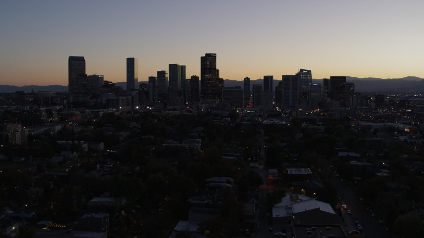 5.7K stock footage aerial video of a reverse view of the city's skyline at twilight, Downtown Denver, Colorado Aerial Stock Footage | DX0001_001865