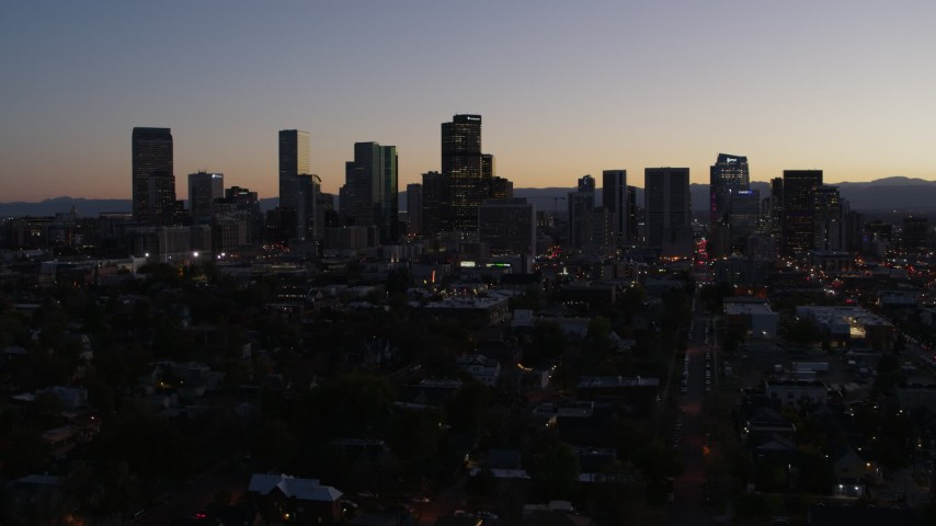 5.7K stock footage aerial video ascend by the city's skyline at twilight, Downtown Denver, Colorado Aerial Stock Footage | DX0001_001869