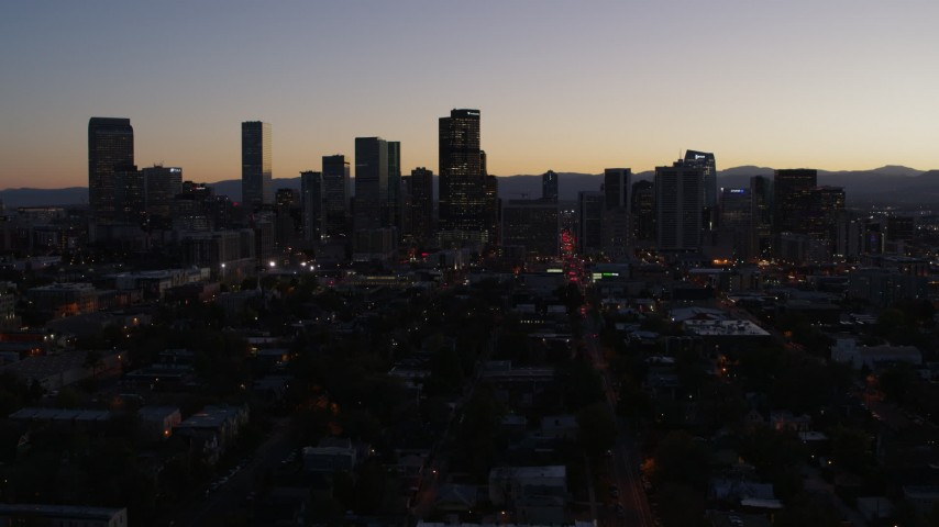 5.7K stock footage aerial video of the city's skyline at twilight during descent, Downtown Denver, Colorado Aerial Stock Footage | DX0001_001870