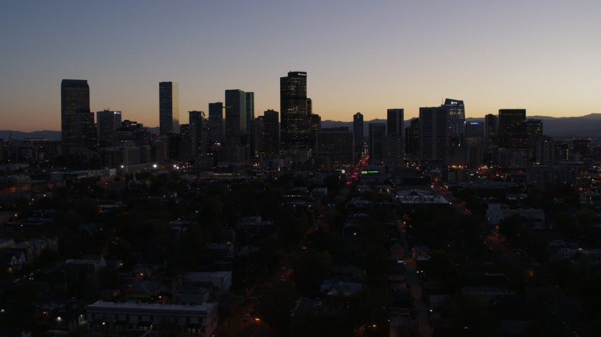 5.7K stock footage aerial video of passing the city's skyline at twilight, Downtown Denver, Colorado Aerial Stock Footage | DX0001_001871
