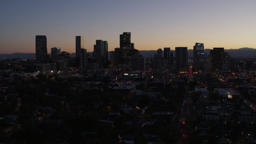 5.7K stock footage aerial video of passing the city's skyline at twilight during slow ascent, Downtown Denver, Colorado Aerial Stock Footage | DX0001_001872