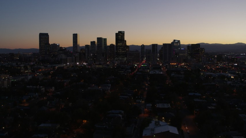 5.7K stock footage aerial video of a slow descent while viewing the city's skyline at twilight, Downtown Denver, Colorado Aerial Stock Footage | DX0001_001877