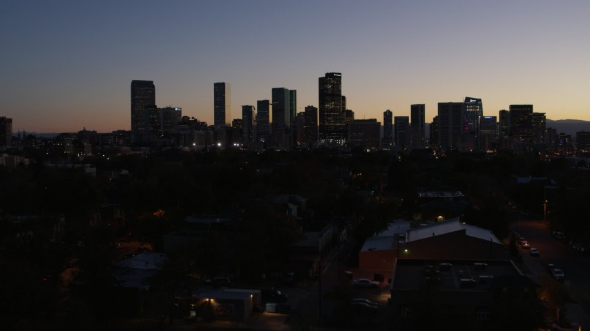 5.7K stock footage aerial video of a slow approach to the city's skyline at twilight and ascend, Downtown Denver, Colorado Aerial Stock Footage | DX0001_001878