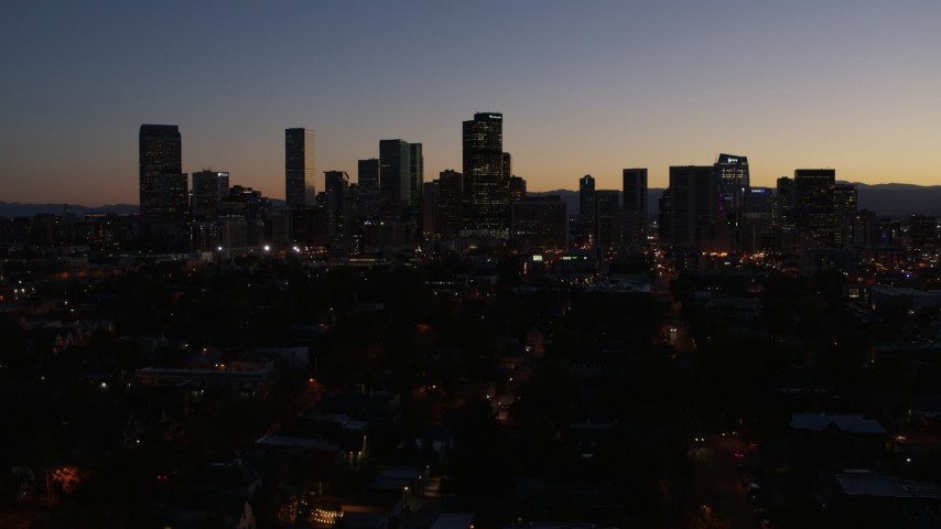 5.7K stock footage aerial video of the city's skyline at twilight during descent, Downtown Denver, Colorado Aerial Stock Footage | DX0001_001882