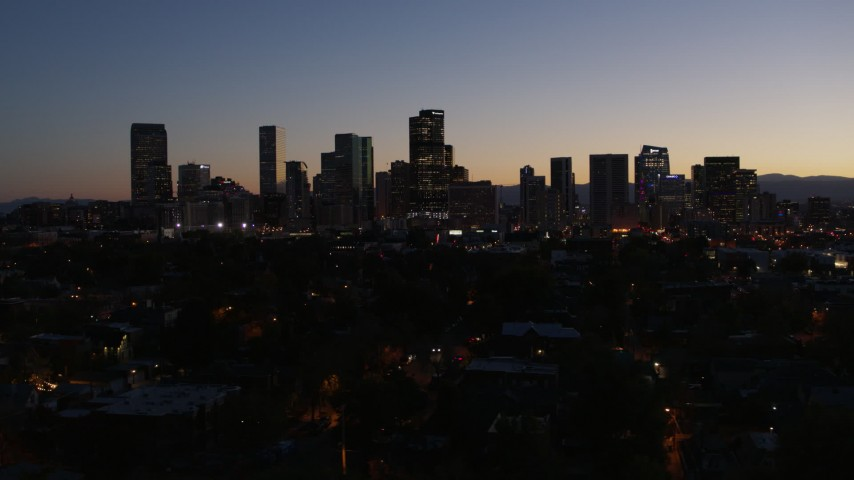 5.7K stock footage aerial video of passing by the city's skyline at twilight, Downtown Denver, Colorado Aerial Stock Footage | DX0001_001883