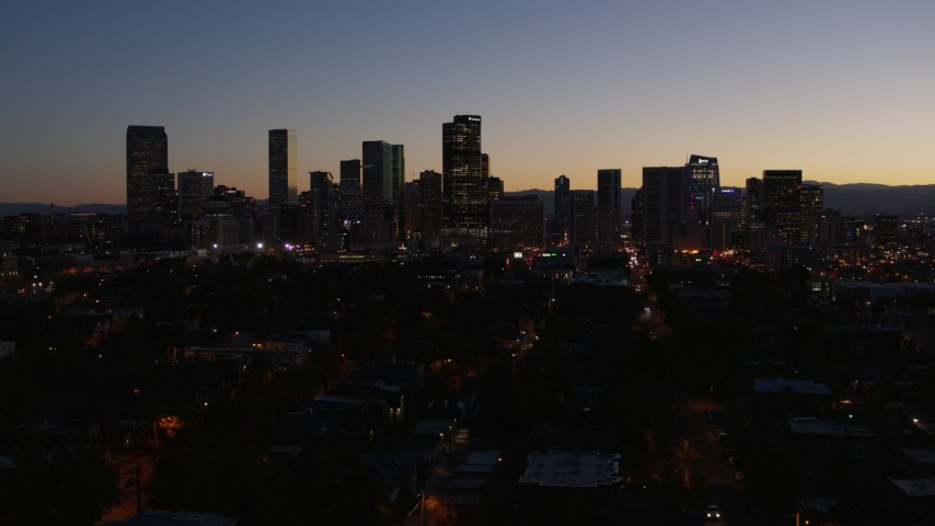 5.7K stock footage aerial video of a reverse view of the city's skyline at twilight, Downtown Denver, Colorado Aerial Stock Footage | DX0001_001885