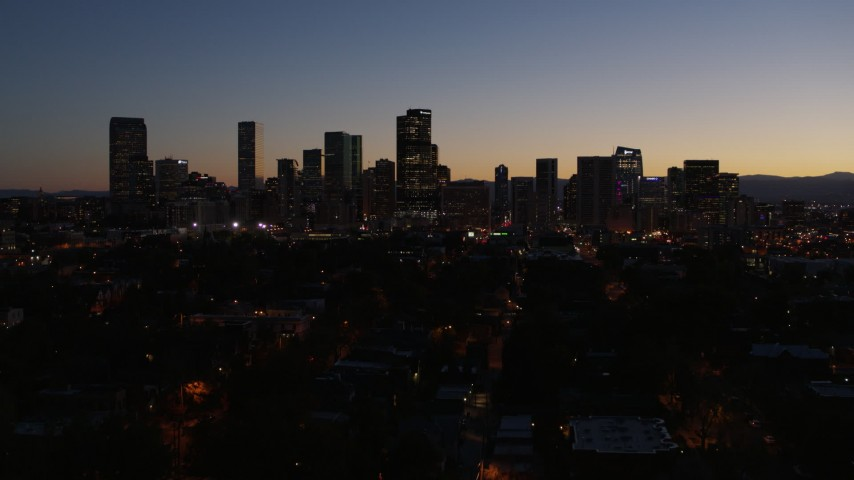 5.7K stock footage aerial video ascend and approach the city's skyline at twilight, Downtown Denver, Colorado Aerial Stock Footage | DX0001_001886