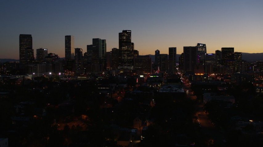 5.7K stock footage aerial video fly away from the city's skyline at twilight and descend, Downtown Denver, Colorado Aerial Stock Footage | DX0001_001887