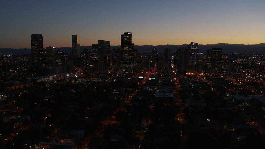 5.7K stock footage aerial video of the city's skyline at twilight while ascending, Downtown Denver, Colorado Aerial Stock Footage | DX0001_001888