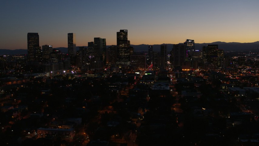 5.7K stock footage aerial video descend while focusing on the city's skyline at twilight while ascending, Downtown Denver, Colorado Aerial Stock Footage | DX0001_001889