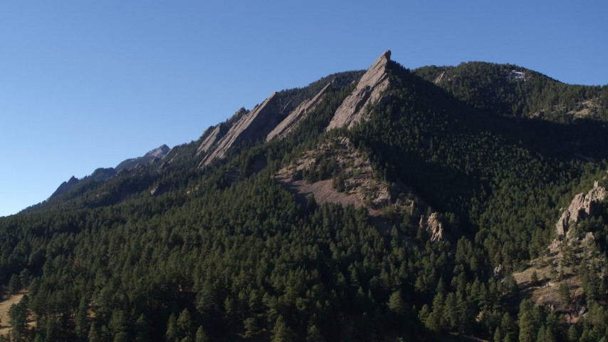 5.7K stock footage aerial video of flying away from and by the flatirons on the side of Green Mountain in the Rocky Mountains, Colorado Aerial Stock Footage | DX0001_001897
