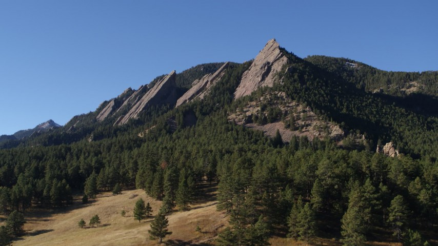 5.7K stock footage aerial video of passing by and fly away from the flatirons on the side of Green Mountain in the Rocky Mountains, Colorado Aerial Stock Footage | DX0001_001899