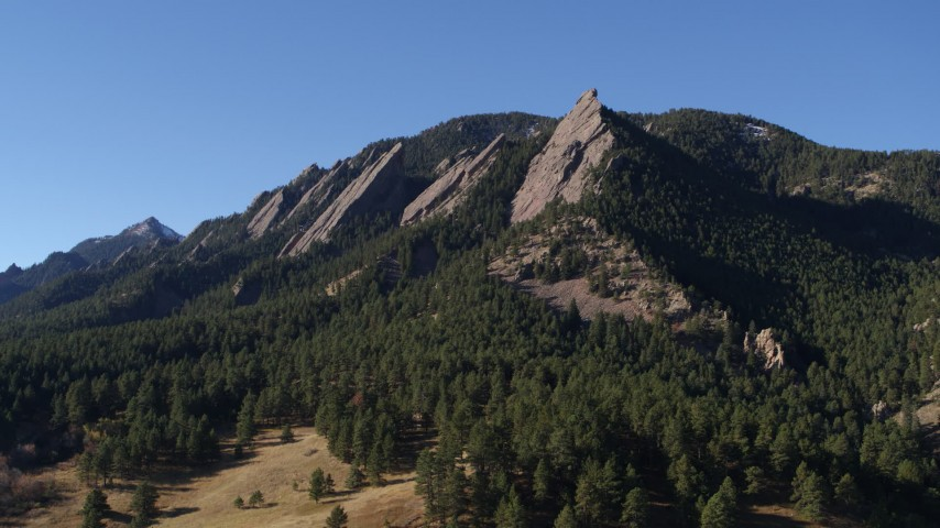 5.7K stock footage aerial video of passing by Green Mountain's flatirons in the Rocky Mountains, Colorado Aerial Stock Footage | DX0001_001900