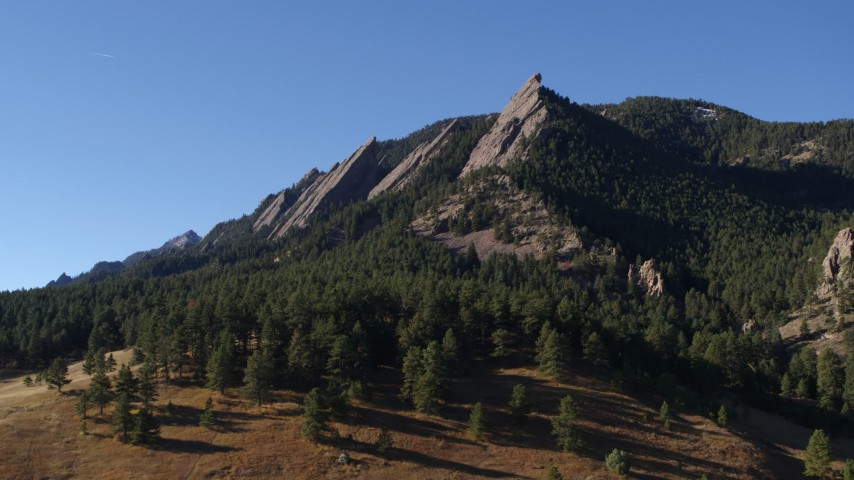 5.7K stock footage aerial video of flying by Green Mountain's flatirons in the Rocky Mountains, Colorado Aerial Stock Footage | DX0001_001901