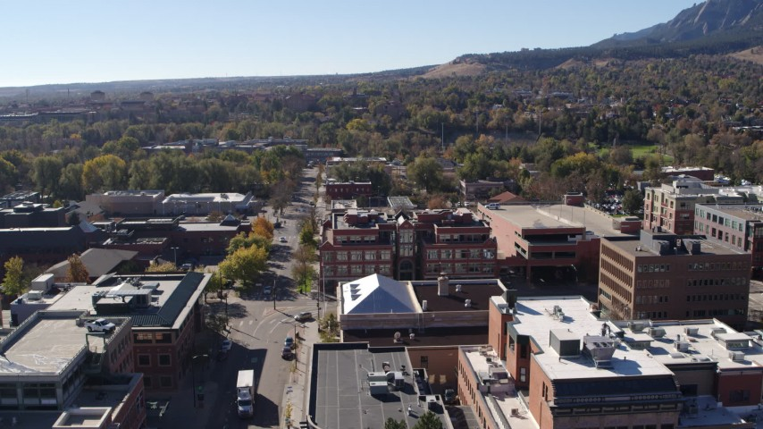 5.7K stock footage aerial video flying by brick office building at quiet intersection in Boulder, Colorado Aerial Stock Footage | DX0001_001905