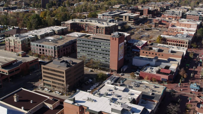 5.7K stock footage aerial video approach a brick office building and ascend in Boulder, Colorado Aerial Stock Footage | DX0001_001909