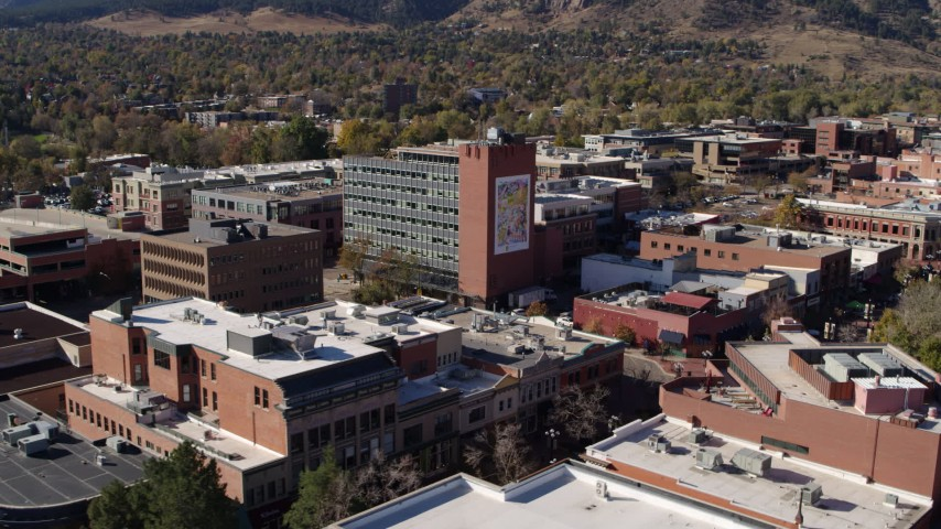 5.7K stock footage aerial video of flying by a brick office building in Boulder, Colorado Aerial Stock Footage | DX0001_001911