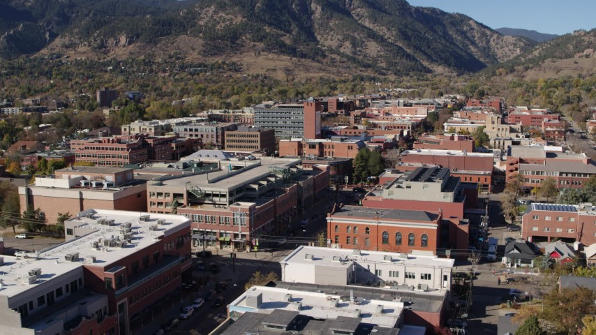 5.7K stock footage aerial video of a stationary view of brick office buildings and shops in Boulder, Colorado Aerial Stock Footage | DX0001_001913