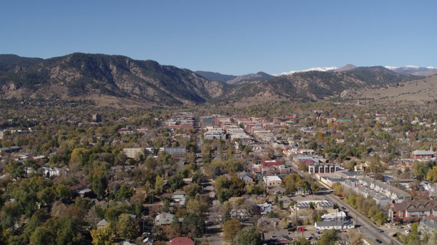 5.7K stock footage aerial video a slow approach to Boulder, Colorado with mountains in background Aerial Stock Footage   DX0001_001917