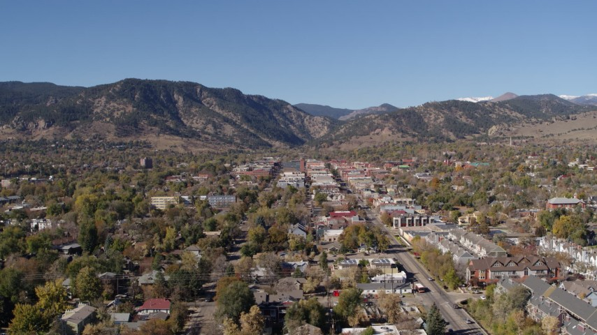 5.7K stock footage aerial video descend with a view of Boulder, Colorado with mountains in background Aerial Stock Footage | DX0001_001919