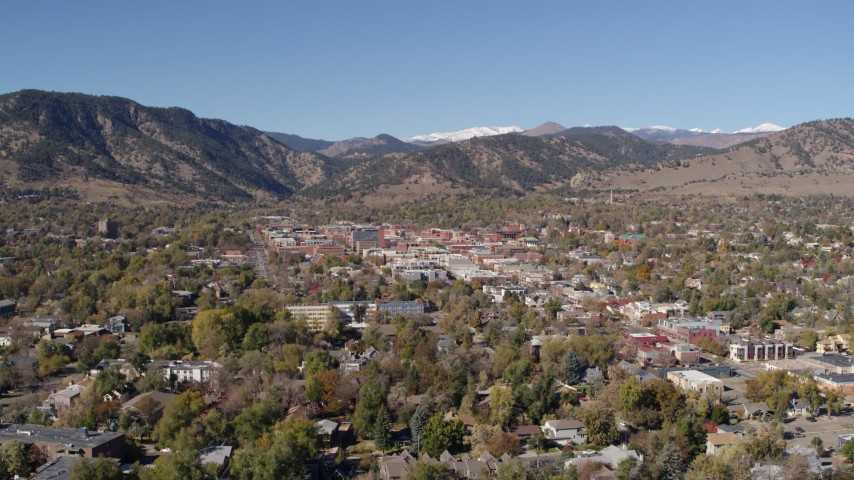 5.7K stock footage aerial video descend and flyby Boulder, Colorado with mountains in background Aerial Stock Footage | DX0001_001923